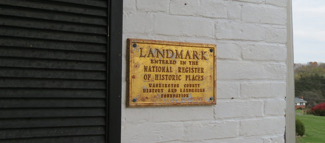 This plaque on the back of the original structure indicates that the house is on the National Register of Historic Places.