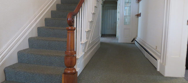 BEFORE: One of the house's most beautiful features is its staircase.