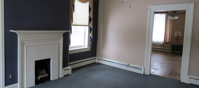 BEFORE: An upstairs room located at the back of the house