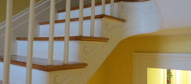 AFTER: The refinished staircase and trim.